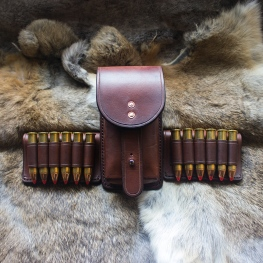Vertical essentials pouch with 45-70 belt slips