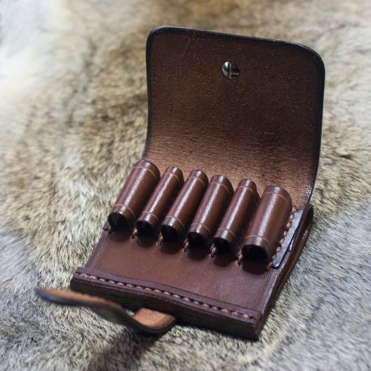 Half closed cartridge belt slip with cover
